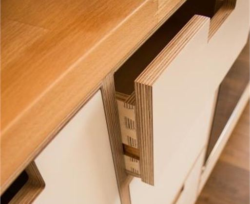 close up view of white melamine birch plywood being used for kitchen drawers