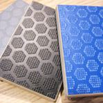 different colour hexagonal pattern plywood lying on table